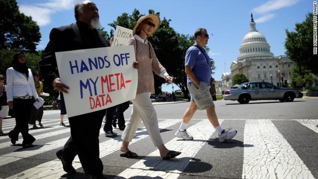 Protesters march outside the U.S. Capitol against the NSA's secret Web surveillance program last month. cnn.com