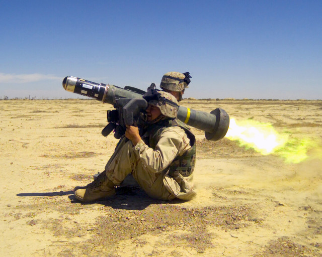 Two US Marine Corps (USMC) members with the 2nd Battalion, 6th Marines fire a Javelin anti-tank missile, at Blair airfield, Iraq, in support of Operation IRAQI FREEDOM.